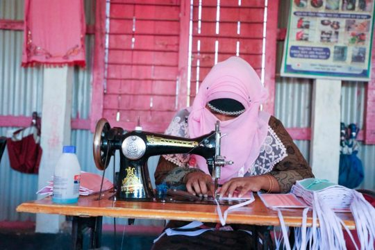 Rohingya-refugee-woman-tailor-making-masks-in-the-camp_Photo-2-by-ISCG-Syed-M.-Tafhim-scaled.jpg